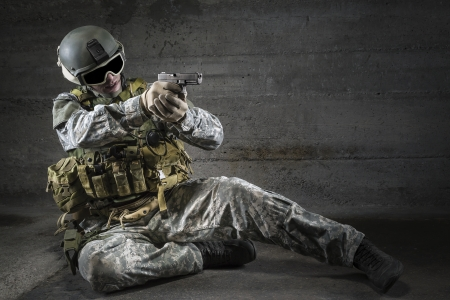 bulletproof vest: Soldier aiming a pistol  Stock Photo