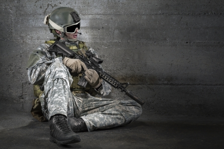 military training: Soldier with rifle and mask resting