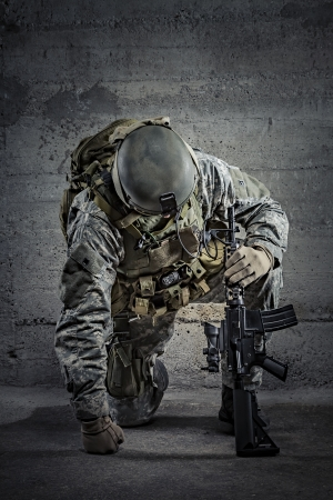 military training: Soldier with rifle and helmet  Stock Photo