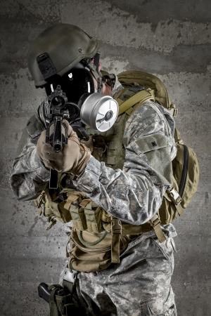 Gas Mask Soldier aiming rifle photo