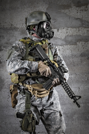 military training: Gas Mask Soldier with a rifle