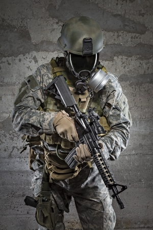 Gas mask soldier with rifle photo