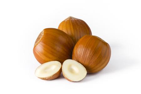 pecans: Isolated group of hazelnuts on white background