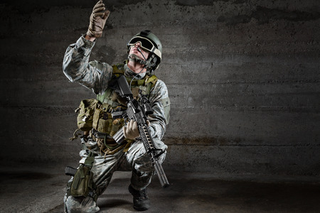 military training: Soldier with mask looking up