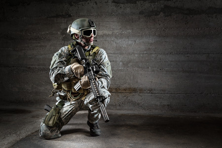 Soldier with mask rifle and backpack photo