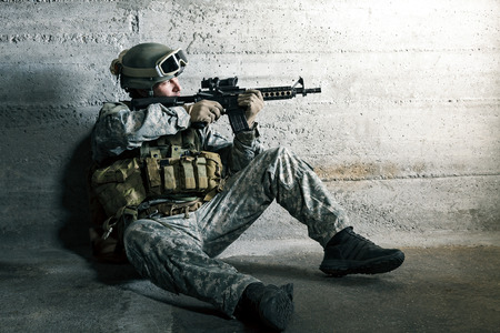 military training: Soldier aiming a rifle