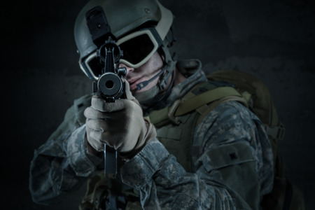 sighting: Soldier aiming a rifle at you Stock Photo