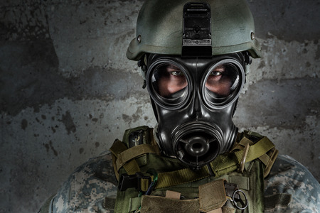 Gas Mask Soldier looking at camera photo