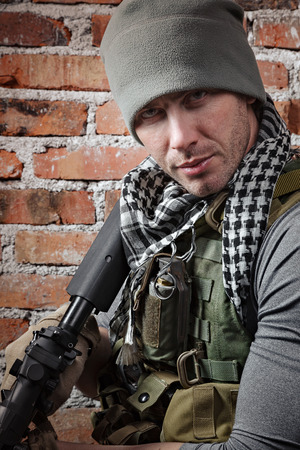 bulletproof vest: Portrait of soldier with rifle looking at camera Stock Photo