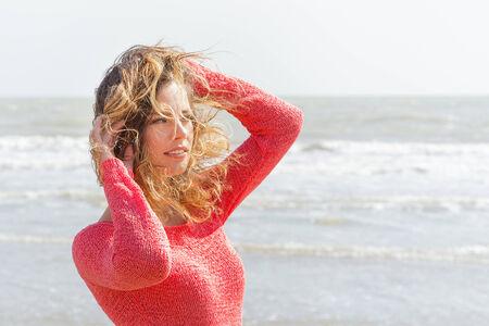 Beautiful wind hair girl on the seaside photo