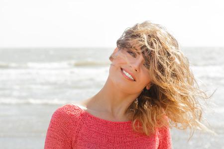 Smiling beautiful green eyes girl on the seaside photo