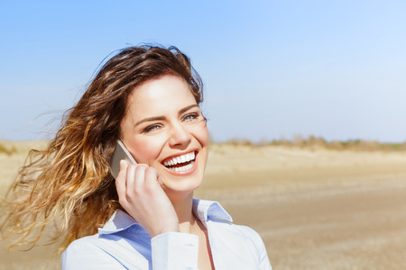 calling on phone: Happy attractive female laughing on the smart phone