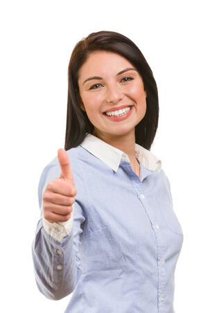 Portrait of young smiling business woman in ok gesture photo