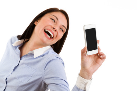 Portrait of young laughing brunette woman taking a self portrait with her phone photo