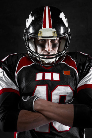 Portrait of american football player with intense gaze