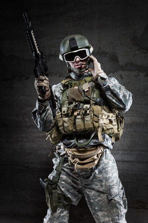 security vest: American Soldier wearing a mask and talking via radio