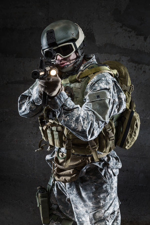 American Soldier with mask rifle and backpack