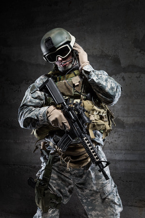 military man: American Soldier wearing a mask and talking via radio