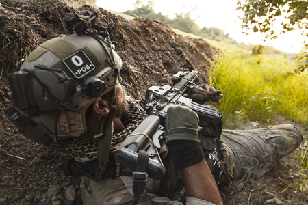 american soldier in the mountains during the military operation Stock Photo