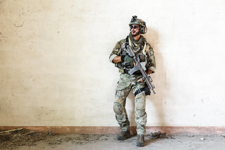 Portrait of american soldier guarding during military operation