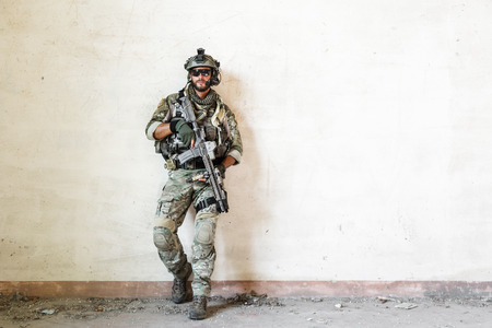military man: Portrait of american poses during military operation