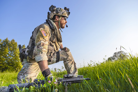 Portrait of American Soldier on blue sky background photo