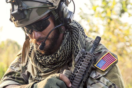 Portrait of American Soldier looking down photo