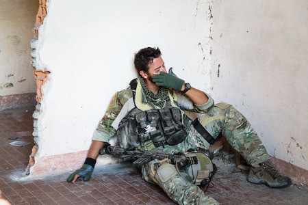 soldiers: Portrait of Crying American Soldier Resting from Military Operation; Indoor Ruins Location