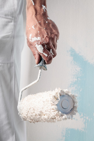 Close up Of Professional Workman Hand holding Dirty Paintroller