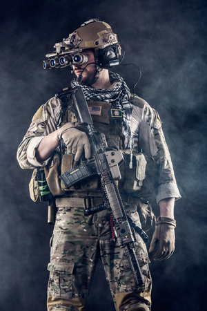 night vision: Portrait of US Army Soldier with Four-eyed night vision goggles in the Smoke; Dark Background