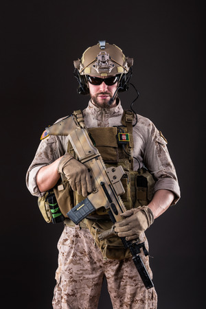 rifle: Portrait of Bearded US Army Soldier on Dark Background