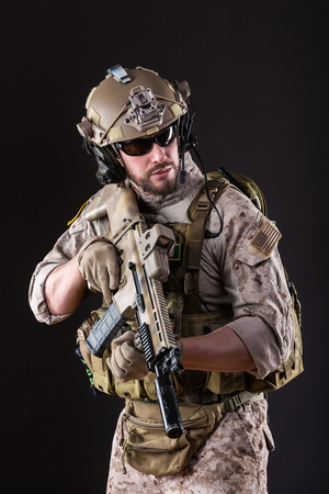 aiming: Portrait of Bearded US Army Soldier on Dark Background
