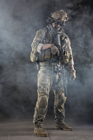 night vision: Portrait of US Army Soldier with Four-eyed night vision goggles in the Smoke; Dark and Foggy Background