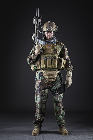 bulletproof vest: Portrait of Bearded US Army Soldier on Dark Background