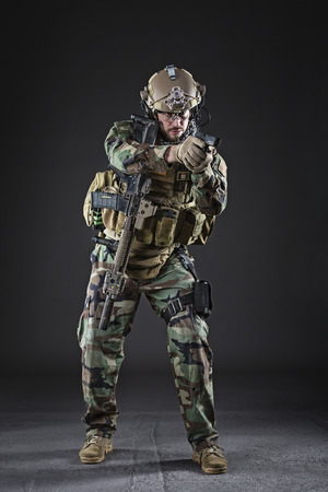 special forces: Portrait of Bearded US Army Soldier on Dark Background