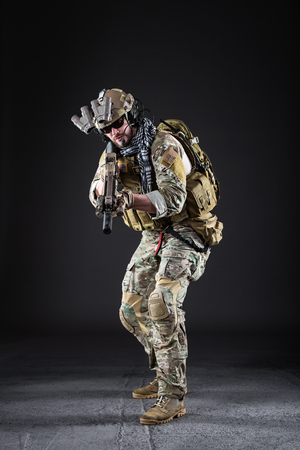 military man: Portrait of Bearded US Army Soldier on Dark Background