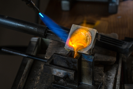 alloy: Metal Casting from Crucible to Metal Mold with blowtorch; Goldsmith Workshop; Close-up