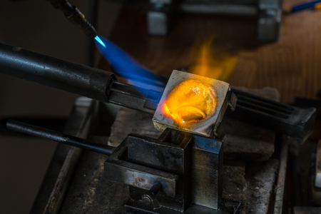 crucible: Metal Casting from Crucible to Metal Mold with blowtorch; Goldsmith Workshop; Close-up