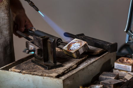 crucible: Melting Silver Grains to liquid state in crucible with blowtorch; Goldsmith Workshop