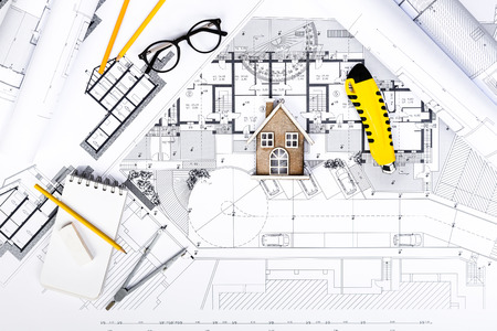 vision repair: Top View of Construction plans with drawing Tools and House Miniature on blueprints; Architectural and Engineering Housing Concept. Stock Photo