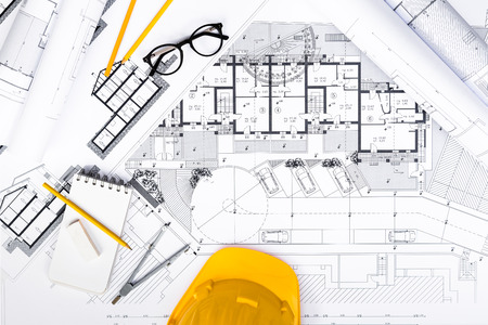Top View of Construction plans with Tablet, drawing and working Tools on blueprints; Architectural and Engineering Housing Concept. Standard-Bild