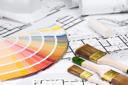 brush painting: Construction plans with whitewashing Tools and Colors Palette on blueprints; Building and Construction Industry Concept