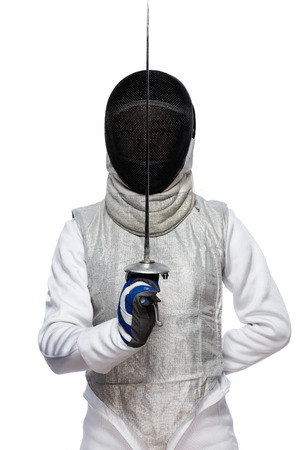 Portrait of Young woman fencer wearing mask and white fencing costume and holding the sword in front of her. Isolated on White Background Foto de archivo