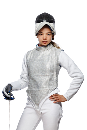 Portrait of Young woman fencer wearing mask and white fencing costume. Isolated on White Background Stock Photo