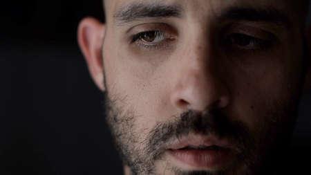 Portrait of worried man. Caucasian man in low key light, shallow depth of field Standard-Bild