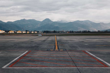 Airport Cargo airline with Colored marking on the floor - The Cargo terminal - Main Airport of Lombardy Italy.