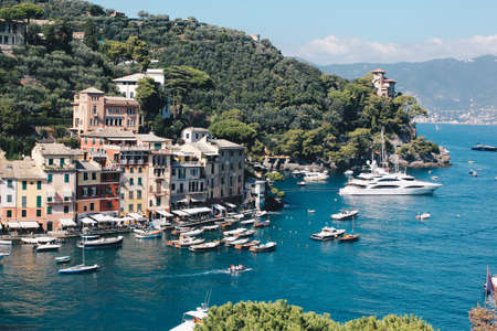 Stunning view in Portofino in Italy with some villas and boats - Travel destination in italy.