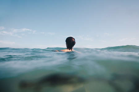 Lonely and desperate woman looking into deep waters.