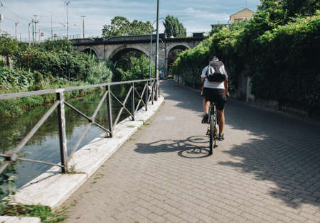 Milan ITALY - July 2018 biker along the Martesana canal in Milan Editöryel