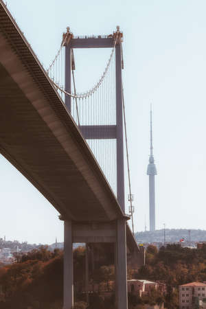 view of the bridge in istanbul from below with a taller tower on the background, turkey Foto de archivo - 112001986